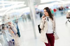 Beautiful woman shopping for clothes Stock Images