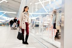 Beautiful woman shopping clothes. Beautiful woman shopping trendy clothes Stock Photography