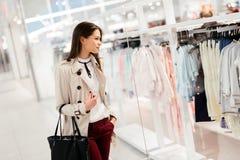 Beautiful woman shopping clothes. Beautiful woman shopping trendy clothes Stock Photos