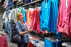 Beautiful woman shopping in clothing store Royalty Free Stock Photography