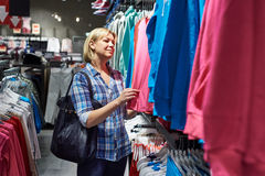 Beautiful woman shopping in clothing store Royalty Free Stock Photo
