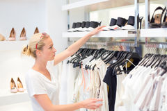 Beautiful woman shopping in clothing store. Stock Photography