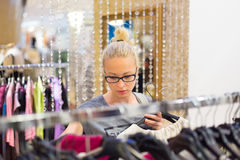Beautiful woman shopping in clothing store. Stock Image