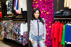 Beautiful woman shopping in clothing store Stock Image