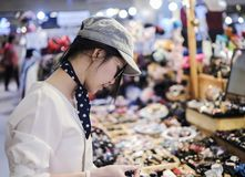 Beautiful woman shopping in festival. For design work Royalty Free Stock Photos