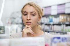 Free Beautiful Woman Shopping For Medicine Royalty Free Stock Photography - 137027797