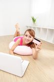 Beautiful woman shopping on internet Stock Images