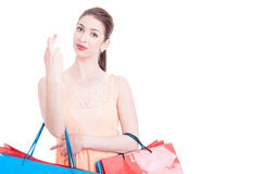 Beautiful woman at shopping making crossed fingers sign Royalty Free Stock Photography