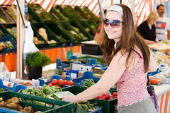 Beautiful woman shopping on the market. Shopping on the market on a summer day Stock Photography