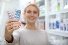 Beautiful woman shopping for medicine stock image