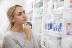 Beautiful woman shopping for medicine stock images