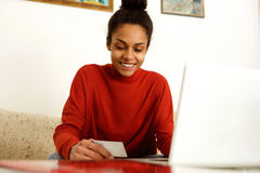 Beautiful woman shopping online with credit card Stock Photo