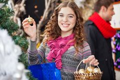 Beautiful Woman Shopping Ornaments At Christmas Stock Photography