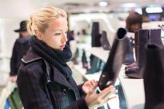 Beautiful woman shopping in shoe store. Stock Photo