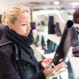 Beautiful woman shopping in shoe store. Stock Photography