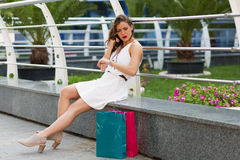 Beautiful woman shopping in the summer city Stock Image