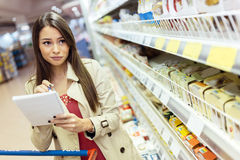 Beautiful woman shopping in supermarket Stock Photo