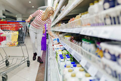 Beautiful woman shopping in supermarket Stock Images