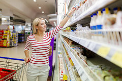 Beautiful woman shopping in supermarket Royalty Free Stock Image