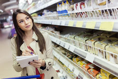 Beautiful woman shopping in supermarket Stock Photography
