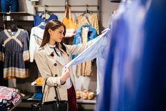 Beautiful woman shopping clothes Stock Photography