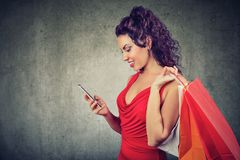Beautiful woman with shoppping bags and smartphone Stock Photography