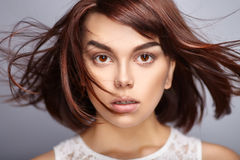 Beautiful woman with short brown hair. Closeup portrait of fashion model posing at studio Royalty Free Stock Images