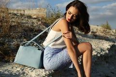 Beautiful woman with short dark hair wears elegant dress Royalty Free Stock Photo