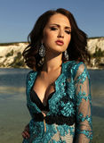 Beautiful woman with short dark hair wears luxurious lace robe Royalty Free Stock Photo