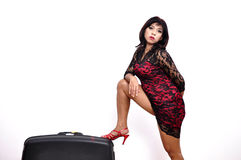 Beautiful woman short dress, red shoes, suitcase Stock Photo
