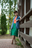 Beautiful woman with short hair posing in park Stock Photo