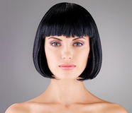 Beautiful woman with shot hairstyle Stock Images