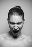 Beautiful woman shouting angry stock photography