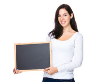 Beautiful woman show with black board Royalty Free Stock Images