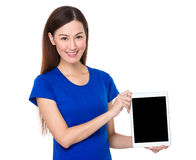 Beautiful woman show with the blank screen of tablet Stock Photo