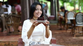 Beautiful woman show cake on her hand and smile stock footage