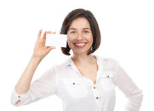 Beautiful woman showing a blank business card Royalty Free Stock Photography