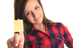 Beautiful woman showing a blank yellow paper note Royalty Free Stock Images