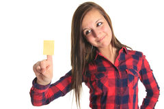 Beautiful woman showing a blank yellow paper note Royalty Free Stock Image