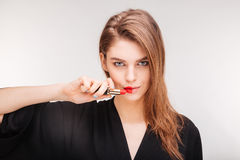 Beautiful woman showing color of lipstick on her lips Royalty Free Stock Photo