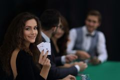 Beautiful woman showing a combination of four aces. Beautiful women showing a combination of four aces. casino and lifestyle Stock Photo