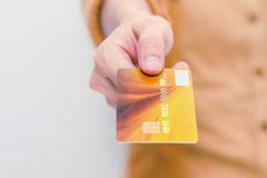 Beautiful woman showing credit card for online payment, hands ho Stock Photo