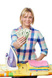 Beautiful woman showing dollars near iron board Royalty Free Stock Photography