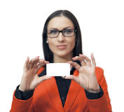Beautiful woman showing empty blank paper card Stock Photo