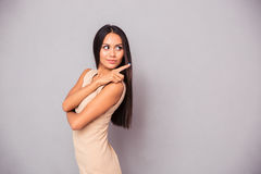 Beautiful woman showing finger away Stock Images