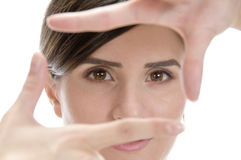 Beautiful woman showing framing hand gesture Royalty Free Stock Image