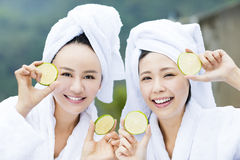 Beautiful woman showing fresh lemon in spa Stock Images