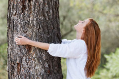 Beautiful woman showing her love of nature Stock Images