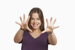 Beautiful woman showing her palms. Isolated in white Royalty Free Stock Photos