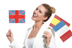 Beautiful woman showing international flags Stock Photos